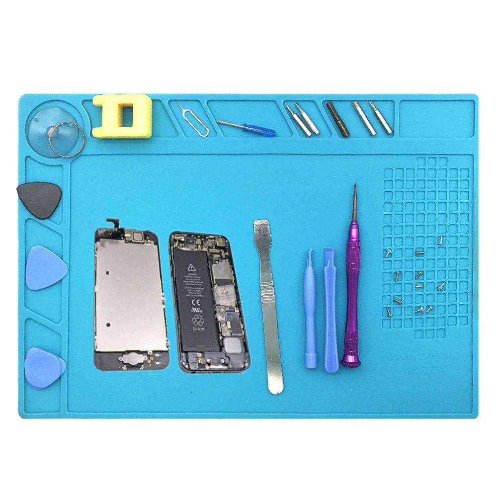 Mesa de trabajo en silicona para reparación de móviles.