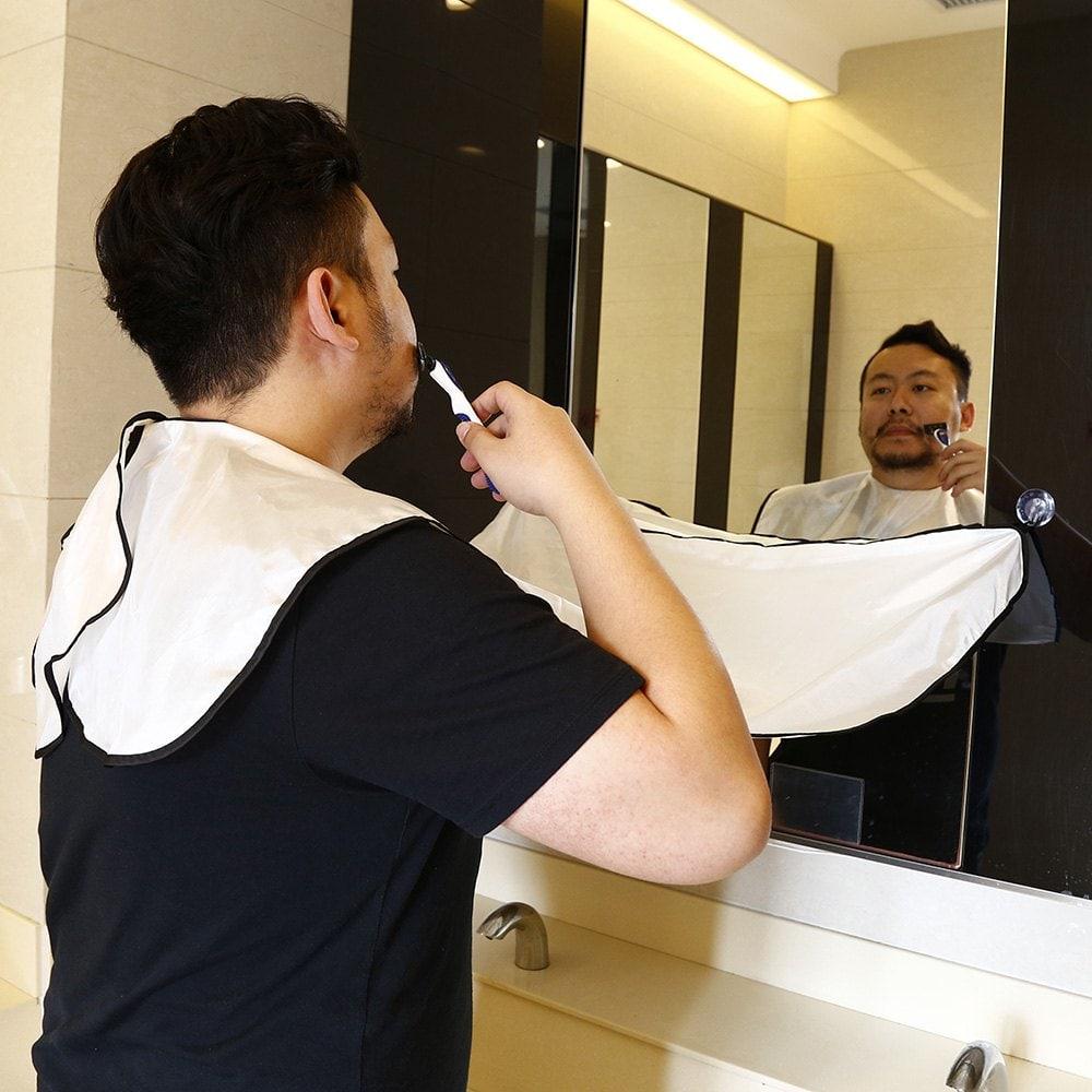 Delantal para el afeitado con ventosas