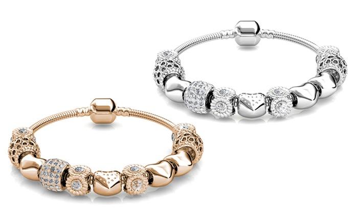 Pulsera con adornos y cristales de Swarovski® chapadas en oro. 9,90€