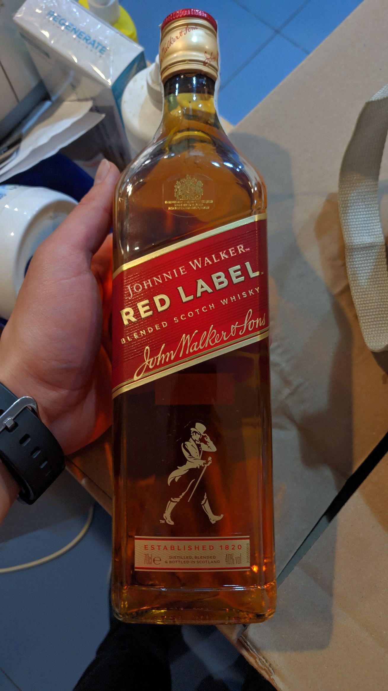 Botella de Red Label en Dia