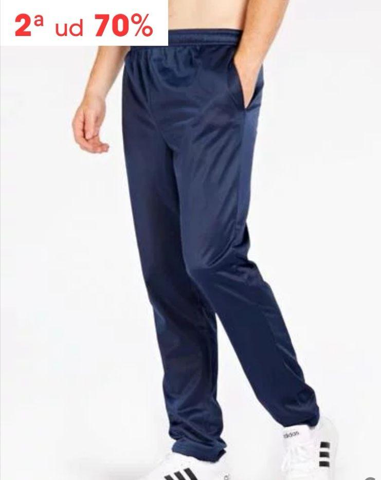Pantalón de chándal con bolsillos laterales y cintura elástica.En azul marino y negro. Tallas S-M-L-XL-2XL.( 2 pantalones X 6.48 €)