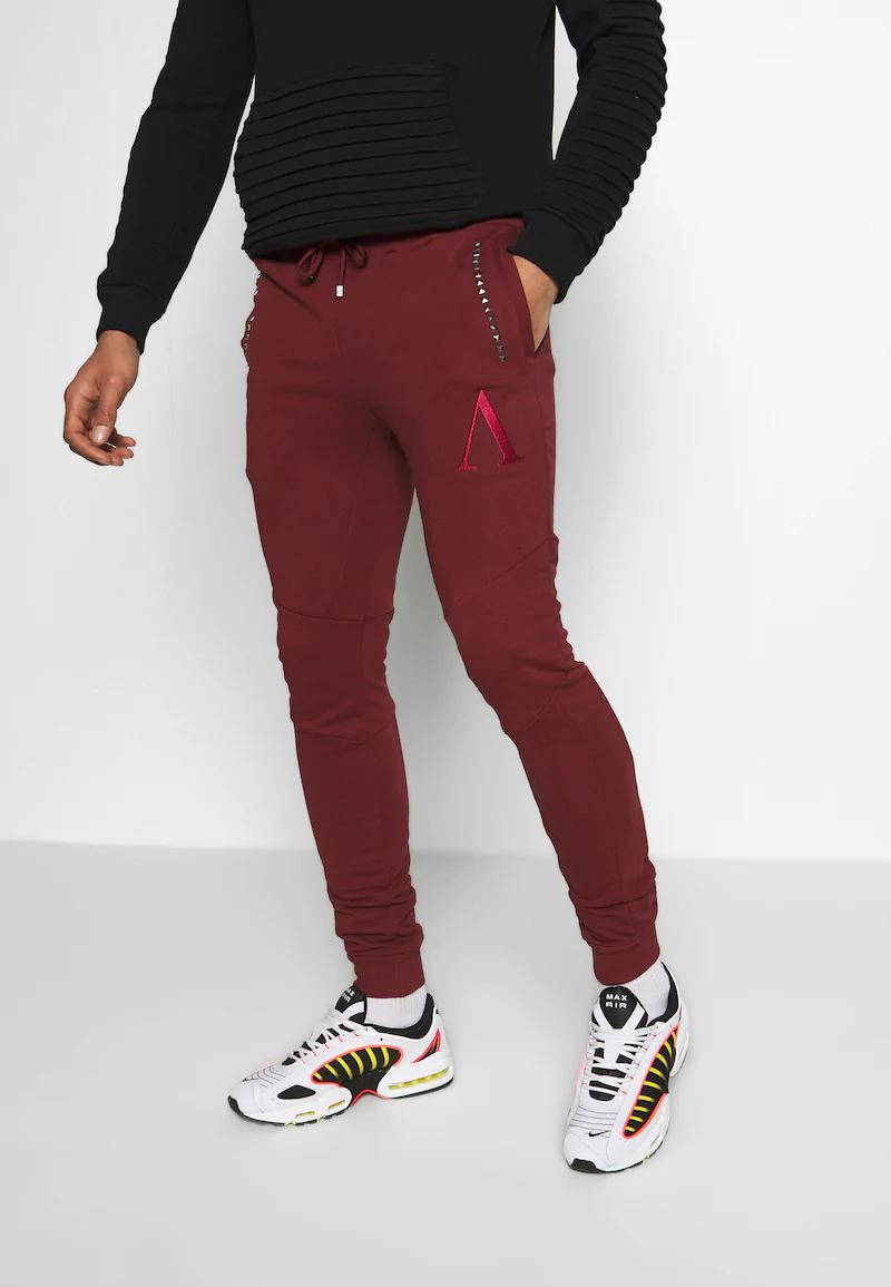 Pantalones AFTERMATH rojos a mitad de precio