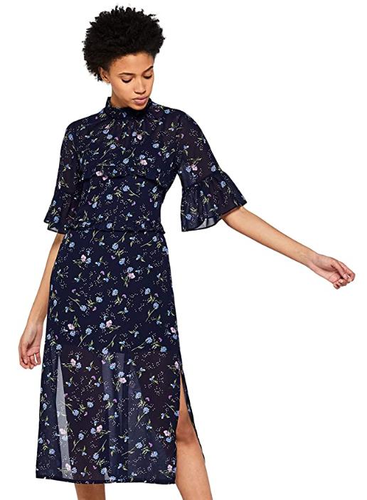 Vestido elegante con estampado de flores sobre fondo oscuro, talla 36.