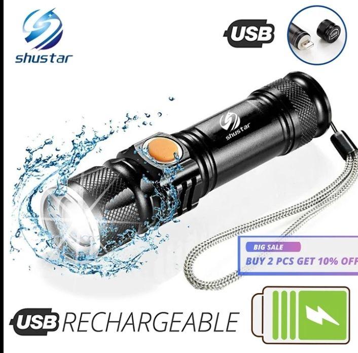 Linterna LED potente con cabezal de carga USB trasero