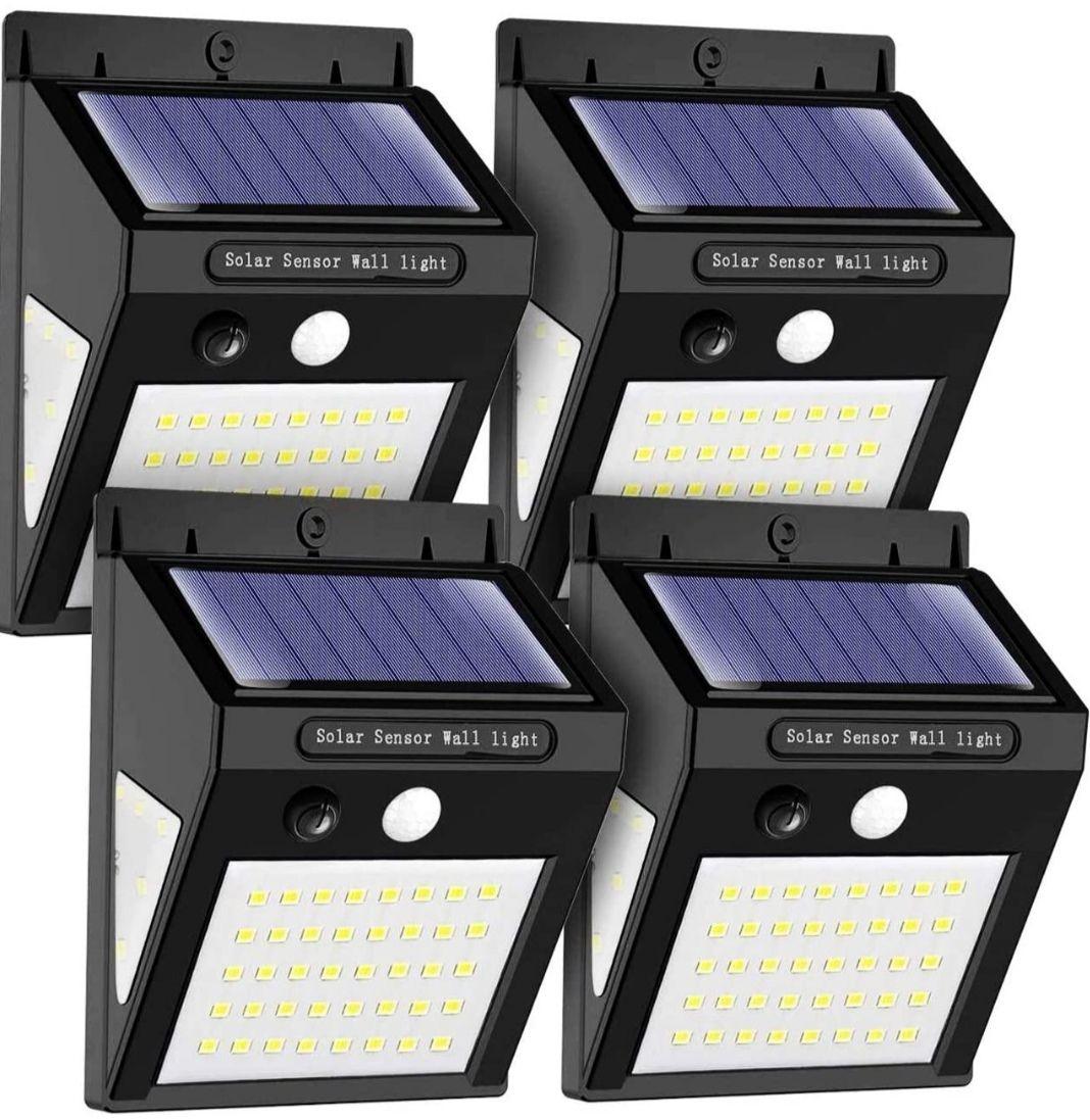 (Pack de 4) Luz LED Solar con Sensor de Movimiento. Gran Ángulo de Iluminación, IP65 Impermeable